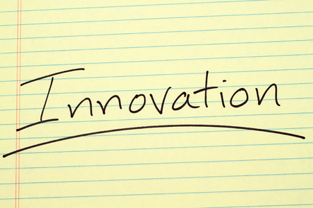 The word Innovation underlined on a yellow legal pad