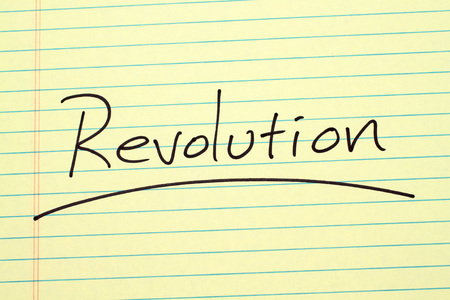 The word Revolution underlined on a yellow legal pad Stock fotó