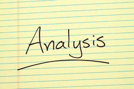 The word Analysis underlined on a yellow legal pad Stock fotó
