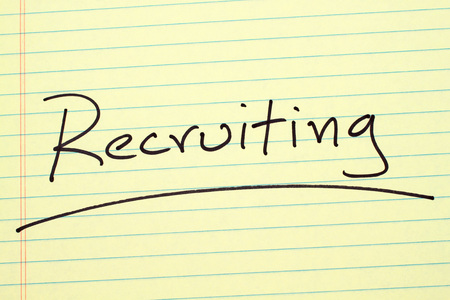 The word Recruiting underlined on a yellow legal pad