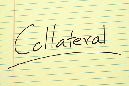 The word Collateral underlined on a yellow legal pad