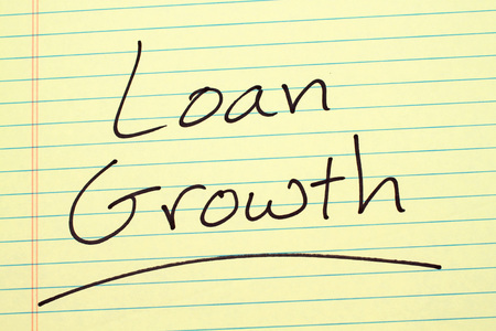 The word Loan Growth underlined on a yellow legal pad