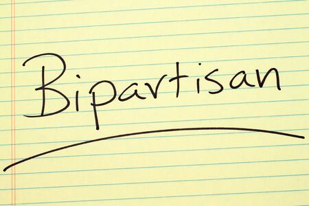 The word Bipartisan underlined on a yellow legal pad