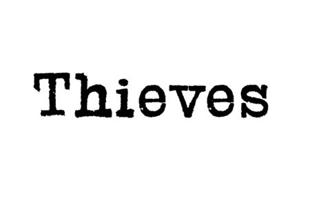 The word Thieves from a typewriter on a white background