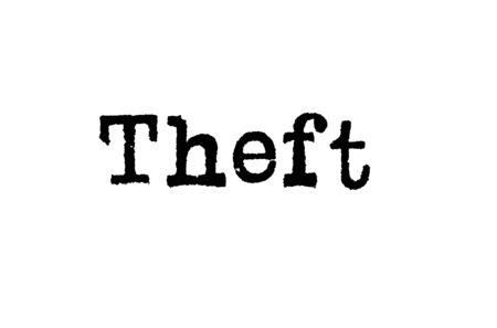 The word Theft from a typewriter on a white background Stok Fotoğraf