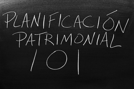 The words Planificación Patrimonial 101 on a blackboard in chalk. Translation: Estate Planning 101 Stock Photo