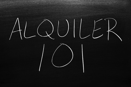 The words Alquiler 101 on a blackboard in chalk.  Translation: Renting 101
