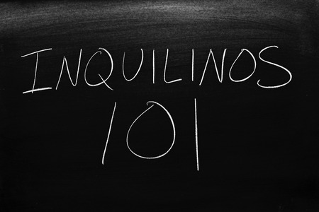 The words Inquilinos 101 on a blackboard in chalk.  Translation: Renters 101