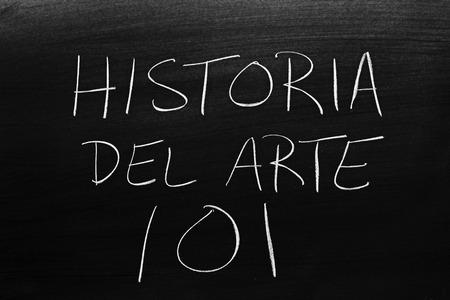 The words Historia Del Arte 101 on a blackboard in chalk.  Translation: Art History 101