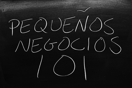 The words Pequeños Negocios 101 on a blackboard in chalk.  Translation: Small Business 101