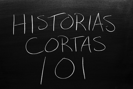 The words Historias Cortas 101 on a blackboard in chalk.  Translation: Short Stories 101 Stock Photo