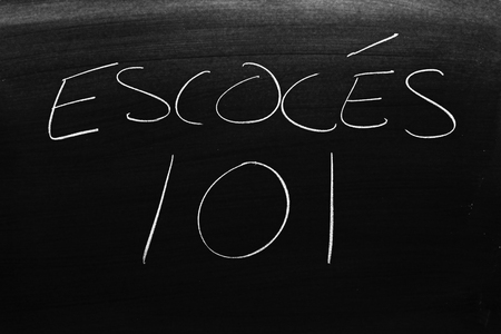 The words Escocés 101 on a blackboard in chalk.  Translation: Scotch 101