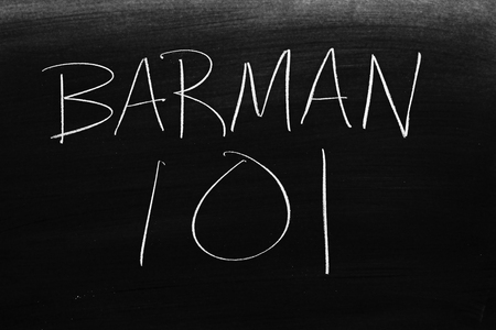 The words Barman 101 on a blackboard in chalk.  Translation: Bartending 101 Stock Photo