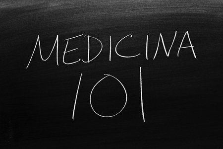 The words Medicina 101 on a blackboard in chalk.  Translation: Medicine 101
