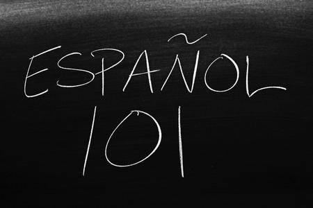 The words Español 101 on a blackboard in chalk.  Translation: Spanish 101 Stock Photo