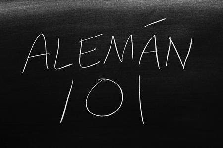 The words Alemán 101 on a blackboard in chalk.  Translation: German 101