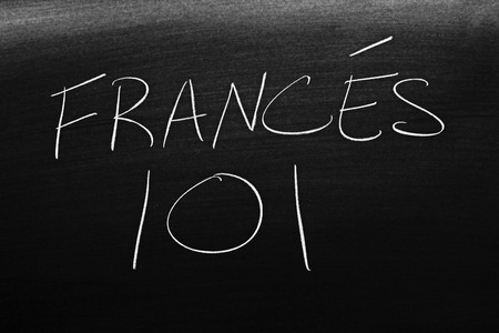 The words Francés 101 on a blackboard in chalk.  Translation: French 101