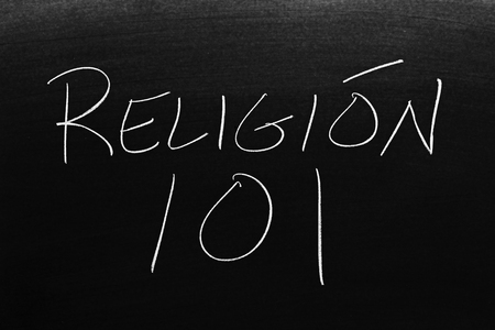 The words Religión 101 on a blackboard in chalk.  Translation: Religion 101