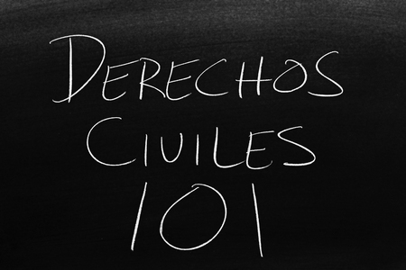 The words Derechos Civiles 101 on a blackboard in chalk.  Translation: Civil Rights 101