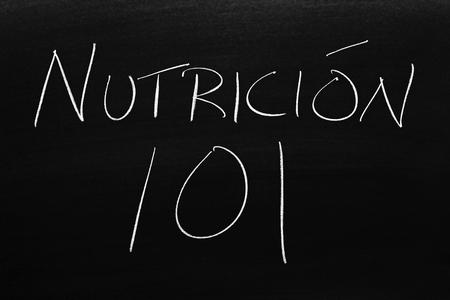The words Nutrición 101 on a blackboard in chalk.  Translation: Nutrition 101