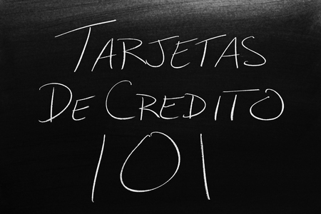 The words Tarjetas De Crédito 101 on a blackboard in chalk.  Translation: Credit Cards 101