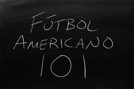 The words Fútbol Americano 101 on a blackboard in chalk.  Translation: Football 101
