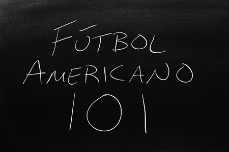 The words Fútbol Americano 101 on a blackboard in chalk.  Translation: Football 101