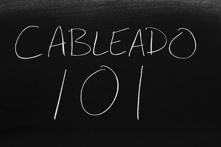 The words Cableado 101 on a blackboard in chalk.  Translation: Wiring 101