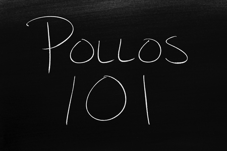 The words Pollos 101 on a blackboard in chalk.  Translation: Chickens 101