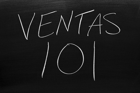 The words Ventas 101 on a blackboard in chalk.  Translation: Sales 101