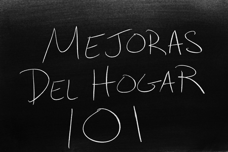 The words Mejoras Del Hogar 101 on a blackboard in chalk.  Translation: Home Improvement 101