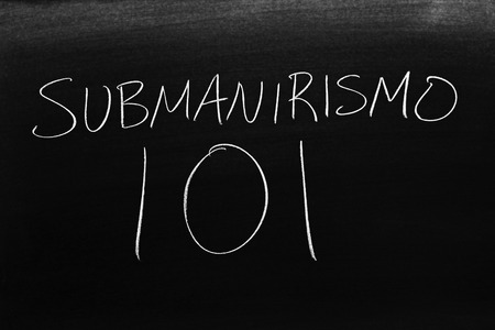 The words Submanirismo 101 on a blackboard in chalk.  Translation: Scuba 101