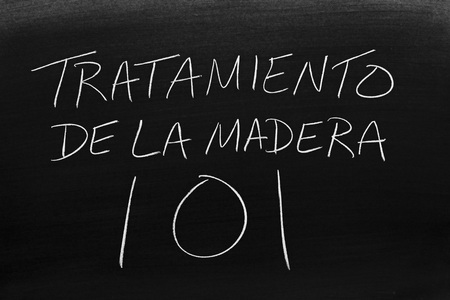The words Tratamiento De La Madera 101 on a blackboard in chalk.  Translation: Woodworking 101
