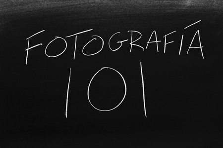 The words Fotografía 101 on a blackboard in chalk.  Translation: Photography 101 Stock fotó