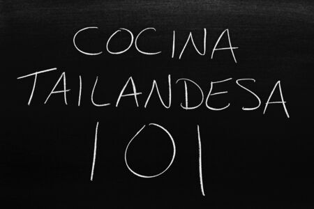 The words Cocina Tailandesa 101 on a blackboard in chalk.  Translation: Thai Cooking 101