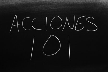The words Acciones 101 on a blackboard in chalk.  Translation: Stocks 101
