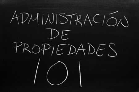 The words Administración De Propiedades 101 on a blackboard in chalk.  Translation: Property Mangement 101 写真素材