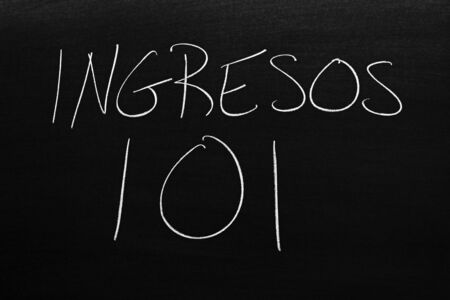 The words Ingresos 101 on a blackboard in chalk.  Translation: Income 101