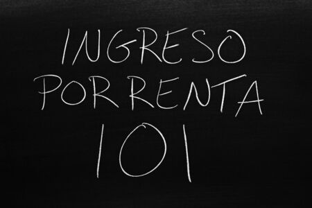 The words Ingreso Por Renta 101 on a blackboard in chalk.  Translation: Rental Income 101