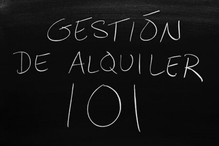 The words Gestión De Alquiler 101 on a blackboard in chalk.  Translation: Rental Management 101