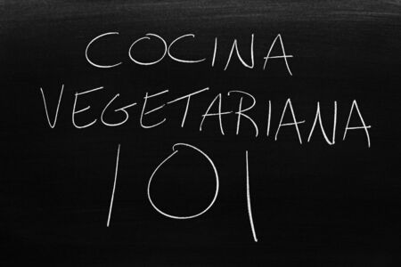 The words Comida Vegetariana 101 on a blackboard in chalk.  Translation: Vegetarian Food 101 写真素材