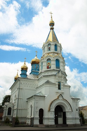 domes: White old christian church with golden domes