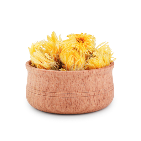 Dried calendula flovers in wooden bawl isolated on white background.