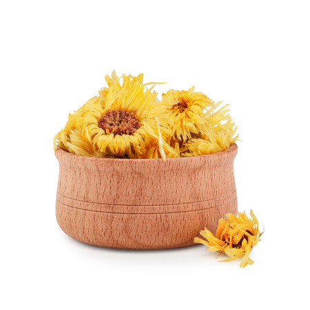 Dried calendula flovers in wooden bawl isolated on white background