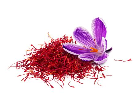 Dried saffron spice with flower isolated on white background