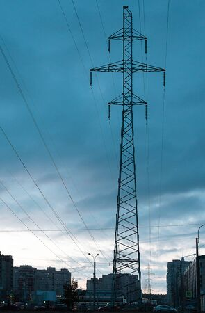 Power lines in a big city in the evening