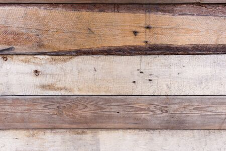 A close up of a wooden fence with different layers