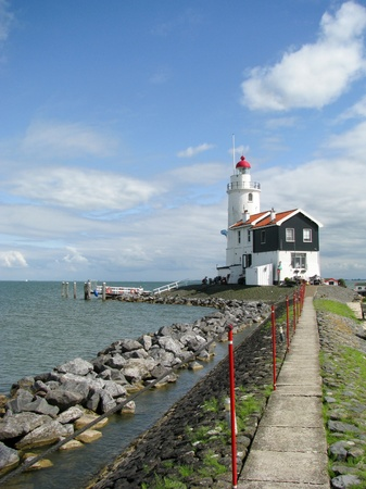 The road to lighthouse, Marken, the Netherlands photo