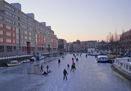 Ice skating on the canals in Amsterdam, the Netherlands Stock Photo - 13046342