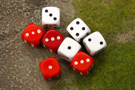 Red and white dices on the playing field Stock Photo - 13091049